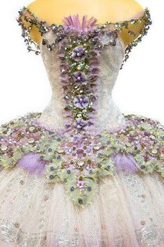 I found 'Costume designed and hand made in London by award winning costume designer Vinilla Burnham, using period silks, antique lace and embroidery, appliqué, crystals and original 1920's gelatine sequins.  Source: theworldofsteam' on Wish, check it out!