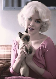Marilyn Monroe and a Siamese.