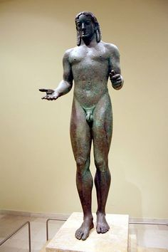 The Piraeus Apollo ca. 530-520 BCE. One of the few archaic Greek bronze statutes to survive. From the last stage in the development of the Kouros that began in the early Archaic period ca. 640-580 BCE. The Piraeus Apollo is late archaic, ca. 530-480 BCE, showing detailed human anatomy almost in motion in a harmonious whole.