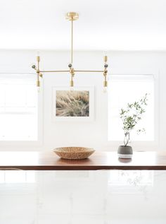 Would love this light fixture in brushed nickel.