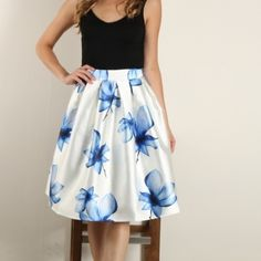 The Blue Floral Midi Skirt The blue floral pleated midi skirt. Hidden back zipper. Lined. Waist measurement (unstretched/stretched) S ~24/28, M ~26/30, L ~30/32  No trades.  No paypal. Instagram: @Citrusandlavenderlane Citrus and Lavender Lane Skirts Midi