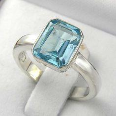Sale! 80.10$ Emerald Cut Blue Topaz Solitare Ring in Argentium by ChadaSoph
