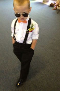 Stud! Ring bearer with suspenders! This is too cute. I like the outfit but in gray with a powder blue shirt and different bowtie