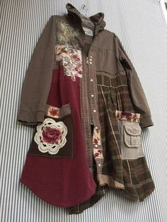 Upcycled Fall Tattered Raw edges Appliqué Patchwork Brown Cotton Hoodie Sweatshirt Jacket, with cute Sweater Patchwork details. I added lots of Appliqué Roses and Vintage Crochet to make this a one of a kind Shabby Boho Chic Autumn Coat. Zip open front 2 big front pockets Nice metal zipper front Casual easy to throw on and go. This Hoodie is a size Large (ladies) It fits cute on small to medium size also - Up to 39 bust Up to 38 Waist 36- 39 long at longest points of the asymmetrical…