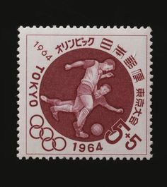 Postage stamp commemorating Tokyo Olympics JAPAN - SEPTEMBER 06: Postage stamp commemorating the Tokyo Olympics, 1964, depicting football match. Japan, 20th century. Japan (Photo by DeAgostini/Getty Images)