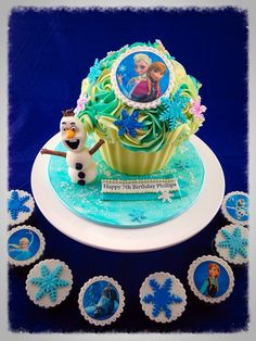 Giant cupcake, Frozen theme with Olaf and edible image toppers, plus cup cakes