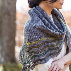 Kelpie – The traditional Shetland hap shawl gets an update with Kelpie. A triangular shawl with colored accents makes a comforting wrap.