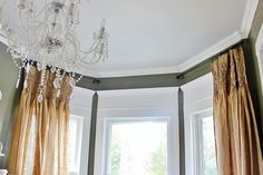 What About That Space Over the Window? - she added the molding above the casing to dress up her window, and it is stunning!