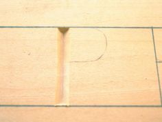 For the P begin by cutting your vertical straight line and then reverse your cut as previously described for an even depth line Carving Letters In Wood, Wood Carving, Chip Carving, Hand Tools, Decorating Tips, Celtic, Magazine, Lettering, Crafts