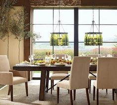 Light chairs, dark wood table, TWO wine bottle chandeliers