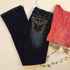 Miss Me Size 28 Boot Cut Jeans Gorgeous pair of Miss Me Boot Cut Jeans. Practically Brand New worn once if that! They are distressed even on the hem. There is bling on the pockets. I can provide more pictures by request. Thanks so much for looking at my closet! Have a fabulous day!  Most important thing! Inseam is 34 inches for you tall girls or the girls that like to wear heels like me. Let me know if you have anymore questions PFF'S Miss Me Jeans Boot Cut