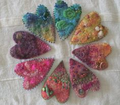 Handfelted brooches with hand stitching and beading. See more work on Facebook page 'Pallywidden' xxx