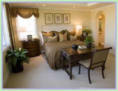 Luxury master bedrooms in mansions - dark brown bed sheets with dark color drapes. Dark wooden chair with dark wooden desk table and night stand. In contrast with beige floor carpet and beige walls. Direct access to master bathroom with no door. Bedroom Carpet, Home Bedroom, Bedroom Chair, Bedroom Apartment, Bedroom Suites, Small Master Bedroom, Master Bedroom Design, Master Bedrooms, Master Bathroom