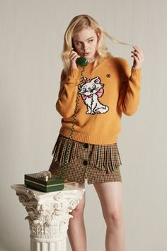 Elle Fanning wears Miu Miu Little Cats sweater collection
