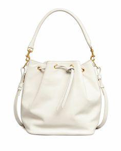 Bucket Shoulder Bag, White by Saint Laurent at Bergdorf Goodman.