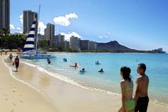 (PHOTO: Mike Nelson/AFP/GettyImages)  10 Easiest Places To Get Eaten By A Shark:  Hawaii (After 14 unprovoked shark attacks were reported in Hawaii in 2013, according to hawaiisharks.com, locals have become increasingly nervous about the risk posed by sharks From 1828 to December 2013 there have been 128 total unprovoked shark attacks in Hawaii, 10 of which were fatal... Picture: Japanese tourists stroll along Waikiki Beach in Hawaii, following a shark siting in 2001, which closed the…