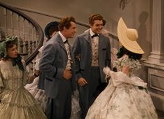 "Vivien Leigh as Scarlett O'Hara with Fred Crane as Brent Tarleton and George Reeves as Stuart Tarleton at the Twelve Oaks barbecue in 'Gone With The Wind'. ""Brent and Stuart Tarleton, you handsome old things, you! """