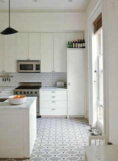 updating white kitchens - all white kitchen with patterned mosaic dot bistro style floor - design sponge at home via atticmag Kitchen Floor Tile Patterns, Patterned Kitchen Tiles, Kitchen Flooring, Tile Floor, All White Kitchen, New Kitchen, White Kitchens, Kitchen Ideas, Kitchen Reno