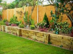Raised flower beds along fence, omg i LOVE this!!!