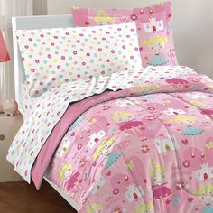 This ultra-soft microfiber comforter set features whimsical cartoon fairy princesses, castles, flowers, hearts, and butterflies on a petal pink ground. A coordinating sheet set showcases colorful tossed flowers on a white ground.