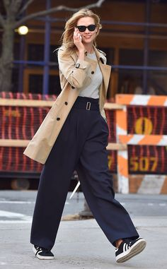 Karlie Kloss from The Big Picture: Today's Hot Pics  The leggy model takes a phone call while making a New York construction site her runway.