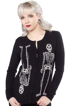 LUCKY 13 69 BONES CARDIGAN This great day of the dead inspired cardigan will have people's heads turning upside down and around! The black fitted cardigan features a print of two skeletons one right side up and one upside down silk screened on the front.