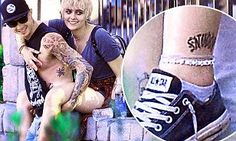 On Thursday, Paris Jackson displayed an ankle tattoo of her boyfriend Michael Snoddy's surname, as she traipsed about Disneyland and Disney California Adventure for Prudence Brando's 21st.