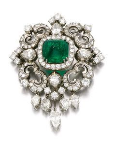 FROM A GERMAN PRINCELY COLLECTION: Emerald and diamond brooch/pendant. Of scroll design, set with a cabochon emerald, single-, brilliant-cut and pear-shaped diamonds. Emerald Earrings, Emerald Jewelry, Diamond Jewelry, Hoop Earrings, Victorian Jewelry, Antique Jewelry, Vintage Jewelry, Art Deco Jewelry, Fine Jewelry