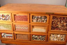 I'm getting one of these seed cabinets for my kitchen island. looking for ideas for the display windows. Seed Storage, Spice Storage, Unique Furniture, Furniture Ideas, Store Counter, Display Windows, Cabinet Fronts, Country House Interior, Down On The Farm