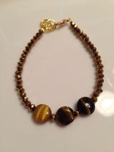 Tiger's eye and Swarovski crystal handmade bracelet Www.facebook.com/BayouBlingLA