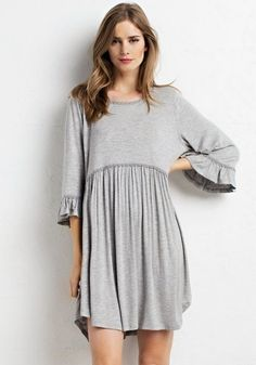 You will fall in love with the ease of this dress. Heather Gray with a slight empire waist and 3/4 sleeves. Ultra-soft pullover style with single button in back. If in-between sizes, we recommend orde