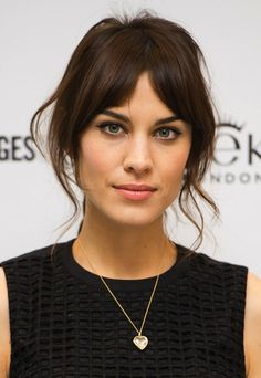 Alexa Chung - her classic perfectly parted & falling fringe with wispy sides (2013 Eyeko launch).