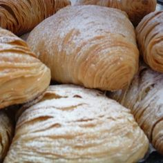 Sfogliatelle Ricce~The history is that the pastry was born in Naples, Italy centuries ago and was usually made by nuns in convents, this pastry was made accidently by a nun using leftover ingredients as it was a sin to waste food