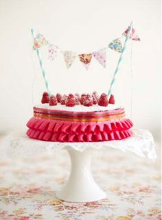 Omg I love this birthday cake @Nellie Chung Chung Chung Lugonot a fan of all the ruffle ribbon, but I like the use of straws