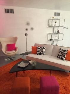 Mid Century Modern Luxe. www.airbnb.com/rooms/14383804 #Chrome #starbursts, #egg chair, #tangerine #boomerang