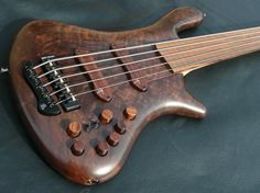 Oh, my God, that grain!  I can only imagine how it must feel to thump that B string with all that walnut...     Jerzy Drozd Soul V Custom Fretless