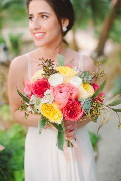 coral, yellow and pink wedding bouquet by fh weddings   http://www.weddingchicks.com/2013/09/20/vintage-destination-wedding/