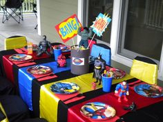 Superhero Party - Love the use of the colored stripes on the table!