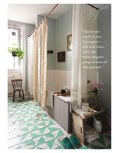 wide plank floor with a pattern, grey and  teal, use wine crates for holding towels under the sink