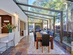 All glass conservatory blends well with the garden for a formal dining room. All glass conservatory blends well with the garden for a formal dining room. Conservatory Dining Room, Modern Conservatory, Glass Conservatory, Conservatory Extension, Glass Roof Extension, House Extension Design, Roof Design, House Design, Sunroom Decorating