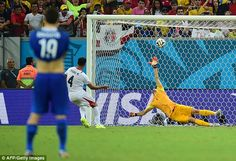 Spot on! Costa Rica's defender Michael Umana scores the winning penalty to send Greece out