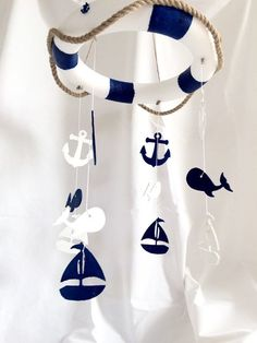 Ahoy Baby Mobile by TheYellophant on Etsy $55 The perfect accessory for your sweet baby nursery. This product works as a baby crib mobile and also for a child/toddler's room. So cute for a nautical baby room or even a nautical themed baby shower or birthday party! This mobile is 12 inches in diameter and hangs about 10 inches long. The lifesaver ring is a lightweight styrofoam ring with rope hung around it. The ornaments are made from recycled wood pieces. Everything is painted and sealed…