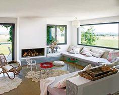 Panoramic window, fireplace, concrete.