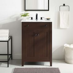 Embrace the subtle sleekness of the Nantucket Bathroom Vanity. Nantucket features crisp lines and a stately design that seamlessly updates your bathroom decor. Solidly constructed from wood and MDF particleboard, the Nantucket Vanity sits on four tapered legs and provides hidden dual storage shelves with soft-close doors. Featuring a curved basin and 8-inch centerset faucet holes, the Nantucket Bathroom Vanity aligns style with function for a modern bathroom. Nantucket comes with non-marking foo 24 Inch Bathroom Vanity, Bathroom Vanity Cabinets, Vanity Sink, Sink Faucets, Bathroom Flooring, Bathroom Furniture, Modern Bathroom, Downstairs Bathroom, Bathroom Vanities