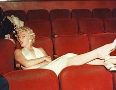 Marilyn Monroe, photographed by Bruno Bernard in the studio screening room, 1954