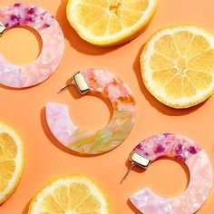 Purple Citrus Resin Hoop Earrings on Mercari Trendy Jewelry, Jewelry Trends, Round Earrings, Women's Earrings, Jewelry Photography, Photography Accessories, Glamour Photography, Lifestyle Photography, Editorial Photography