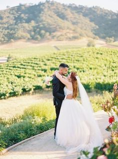 """Kelcie and Brian exchanged their vows in the gorgeous Clos LaChance Vineyard in California. Their bright colors paired so perfectly with the greenery. We especially love their fun """"holey matrimony"""" donut wall! Budget Wedding, Plan Your Wedding, Destination Wedding, Wedding Locations, Wedding Venues, Groom Shoes, Wedding Venue Inspiration, Real Weddings, Summer Weddings"""