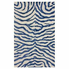 Hand-tufted wool-blend rug with a zebra print motif.  Product: RugConstruction Material: Wool and viscoseColor: Royal blueFeatures: Hand-tufted Note: Please be aware that actual colors may vary from those shown on your screen. Accent rugs may also not show the entire pattern that the corresponding area rugs have.Cleaning and Care: These rugs can be spot treated with a mild detergent and water. Professional cleaning is recommended if necessary.