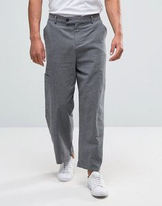 Get this Asos's wide leg trousers now! Click for more details. Worldwide shipping. ASOS Wide Leg Crop Smart Cargo Trousers In Charcoal - Grey: Trousers by ASOS, Woven fabric, Zip fly with button fastening, Side pockets and two back pockets, Wide-cut leg, Loose fit � falls loosely over the body, Machine wash, 49% Polyester, 28% Viscose, 23% Cotton, Our model wears a W 32 L 32 and is 6'2�/188 cm tall. ASOS menswear shuts down the new season with the latest trends and the coolest products, d...