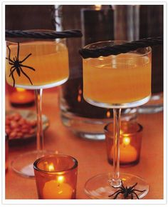 Halloween Party Cocktails Bbf i just like the spiders and votive holders here.